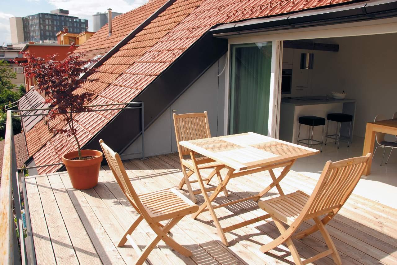 Дизайн мансарды с балконом